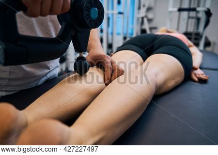 Close Up Percussion Massage For Woman In Rehabilitation Centers Therapeutic Office. Man Masseur