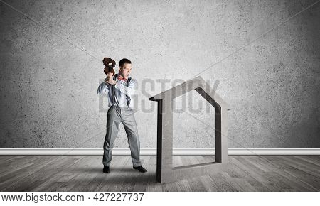 Determined Businessman Going To Break With Violin House Concrete Figure