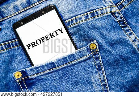 Property The Text Is Written On The White Screen Of The Phone Shortly Lies In Jeans. Word