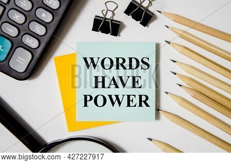 Words Have Power Text Written On A White Notepad With Colored Pencils And A Yellow Background