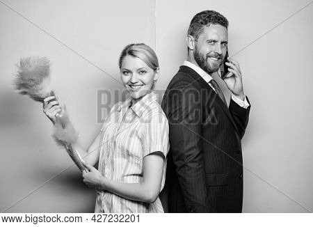 Family Couple. Wife Stand With Dust Brush Husband Has Phone Conversation. Housekeeping Routine. Coup