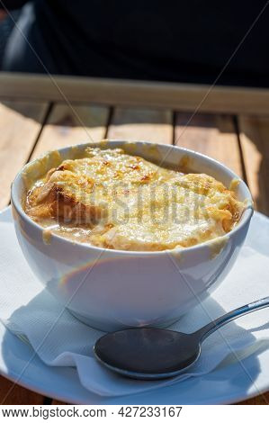 French Caramelized Onion Soup With Croutons And Gruyere Cheesse From Oven