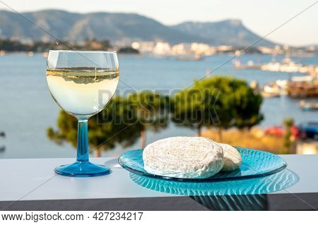 Summer On French Riviera, Drinking Cold White Wine From Cotes De Provence On Outdoor Terrase With Vi