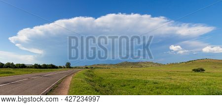 Russian Summer Panoramic Landscape With Rural Road Among Sunny Fields And Green Hills. Great Heaven