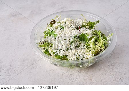 Salad Of Fresh Vegetables With Cheese In Transparent Plastic Container. Designer Food Concept For Ta