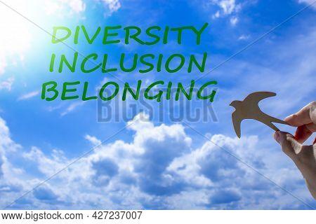 Diversity, Inclusion, Belonging Symbol. Businessman Holds Wood Bird On Cloud Blue Sky Background. Wo