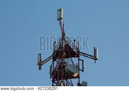 Telecommunication Towers With Wireless Antennas On Sky Background. Cellular Phone Antenna. Technolog