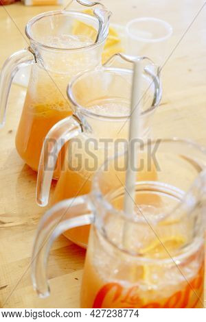 Fruit Juice Cocktail In Pitchers To Serve To Diners.