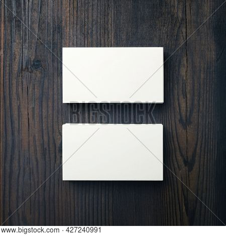 Mockup Of Blank Business Cards On Wood Table Background. Top View. Flat Lay.