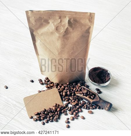 Still Life With Coffee Beans, Kraft Paper Package, Ground Powder And Vintage Business Cards.