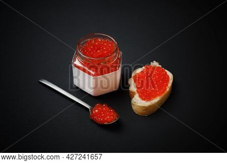 Delicious Fresh Red Caviar. Sandwich With Red Caviar, Glass Jar And Spoon.
