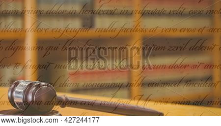 Constitution text against close up of mallet in the court room. american law and justice concept
