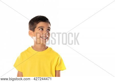 Daydreaming boy looking up isolated on a white background