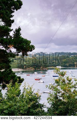 Panoramic view with sailor boats near a small village in the north of Spain