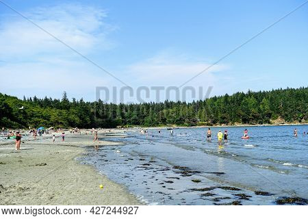 Hornby Island, British Columbia, Canada - July 8th, 2021: A Crowded Sandy Beach Full Of Locals And T