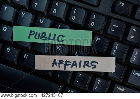 Public Affairs Write On Sticky Notes Isolated On Wooden Table.