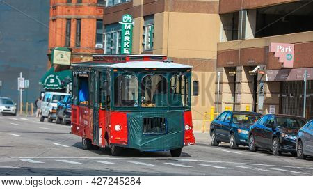 Detroit, MI USA - August 30, 2020: Wine tasting trolley tour bus in Detroit downtown streets, stops at several iconic Detroit destinations.