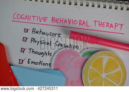 Cognitive Behavioral Therapy Write On A Book With Keywords Isolated On Wooden Table. Chart Or Mechan