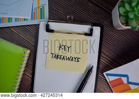 Key Takeaways Write On Sticky Notes Isolated On Wooden Table.