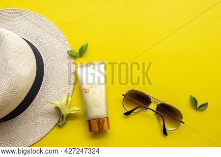 Sunscreen Spf50 Cosmetics Health Care For Skin Face With Sunglasses And Hat Of Lifestyle Woman Relax