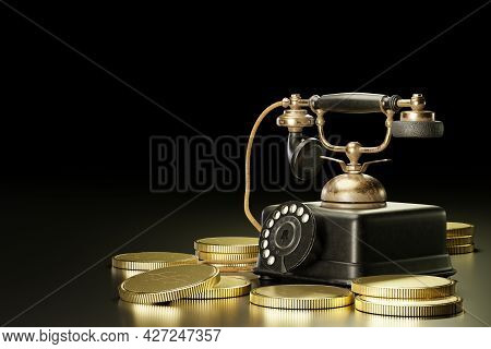 Vintage Telephone Set On Top Of Stacked Gold Coins In A Dark Black Background. The Concept Of Busine