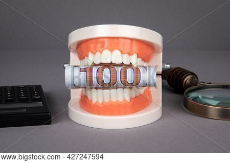 One Hundred Dollar Bill. Dental Health Expenses And Cost