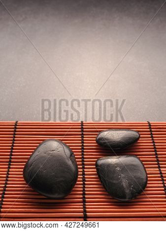 Three Hot Stones Massage Stones On A Bamboo Mat, Health Care, Aromatherapy, Header Or Backdrop