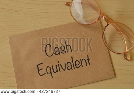Eyeglasses And Envelope Written With Cash Equivalent
