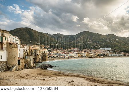 An empty beach in Cefalu old town at cloudy day, Sicily, Italy