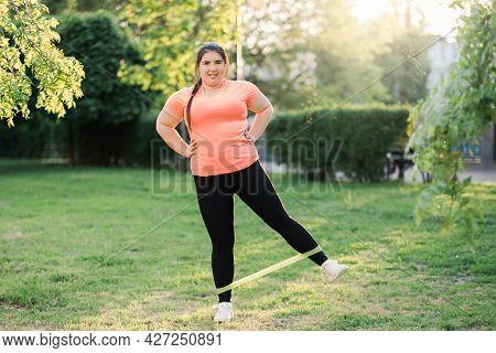 Fitness Outdoor. Overweight Exercise. Park Activity. Body Positive. Joyful Overweight Woman In Sport