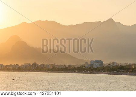 Antalya Konyaalti beach at sunset. Antalya mountains and Mediterranean sea landscape, Turkey