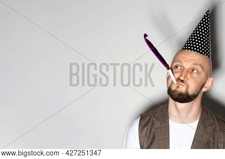 Funny Celebration. Silly Man. Birthday Holiday. Party Joy. Funny Guy Casual Look Wearing Festive Hat