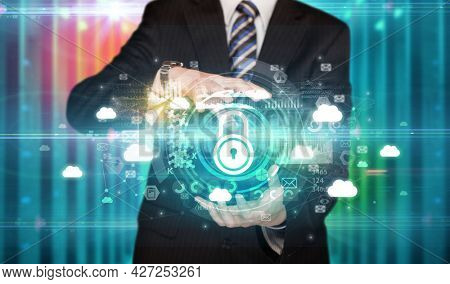 Businessman holding technology icon concept