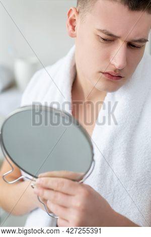 Sensitive Skin. Face Care. Dermatology Problem. After Shave. Worried Confused Young Handsome Man Whi
