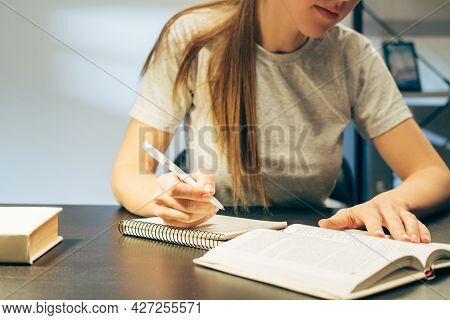Self Education. Distant Learning. Pandemia Lockdown Lifestyle. Student Girl Writing Out Notes From B