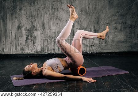 Muscular Young Athletic Woman With Perfect Beautiful Body In Sportswear Doing Exercises Using Fitnes