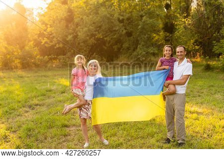 Family With The Flag Of Ukraine. Happy Independence Day Of Ukraine. National Flag Day. Love For The