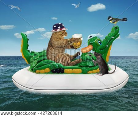 A Beige Cat In A Straw Hat With A Mug Of Beer Is Floating On An Inflatable Crocodile In The Sea At A