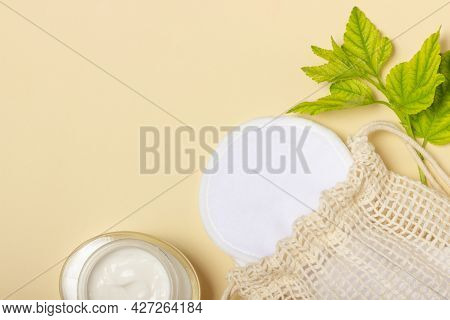 Cotton Reusable Make-up Remover Pads In A Cloth Bag And Face Wash And Cleanser On A Beige Background