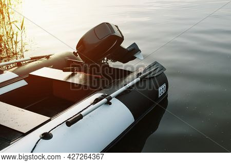 Inflatable Motor Boat On The Water Near The Shore, Outside. Calm Water, Sunset, Selective Focus On T