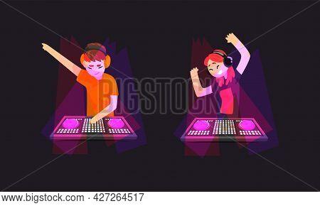 Dj Playing Progressive Electro Music At Nightclub Set, Dj Standing At Spotlights Making Modern Music