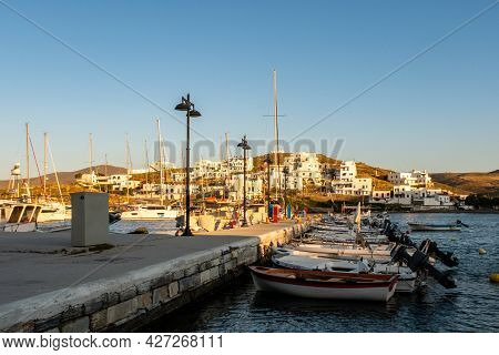 Loutra, Kythnos, Greece, 03.06.2019. Row Of Sailing And Fishing Boats Moored At The Pier In Loutra M