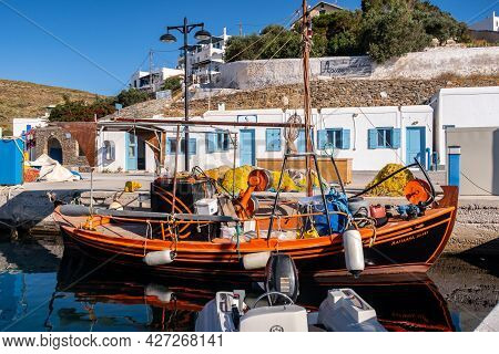 Loutra, Kythnos, Greece, 03.06.2019. Colorful Old Wooden Fishing Boat Moored At The Pier In Loutra M