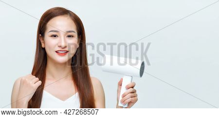 Young Woman Makes Hair Volume With Hairdryer In Hand On White Background
