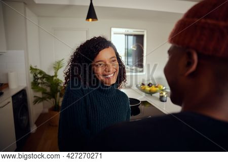 Mixed Race Couple Drinking Coffee Together. Young, Happy African American Woman Smiling At Her Male