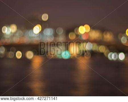 Bokeh City Lights Background. Bokeh Of Cityscape Skyline During Evening Dark Blue Sunset, Dusk Twili