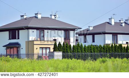New Single Family House In A New Development Area. Residential Home With Modern Facade.