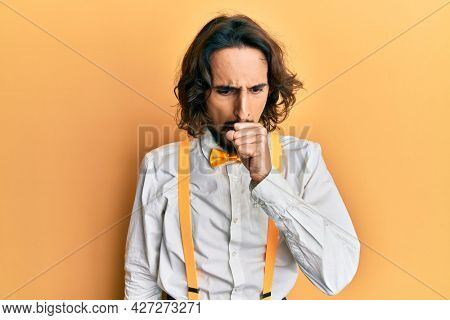 Young hispanic man wearing hipster elegant look feeling unwell and coughing as symptom for cold or bronchitis. health care concept.