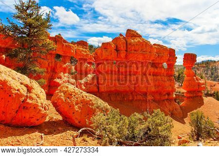 Red-brown canyons and outliers are composed of soft sedimentary rocks. Scenic spots of America. Sunny day. USA. The most popular trails in Red Canyon.