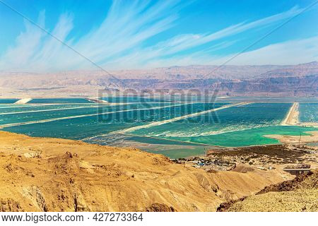The Drying Dead Sea. Windy spring day. Cirrus clouds fly in the blue sky. Salty sea waters between the shores of Israel and Jordan.